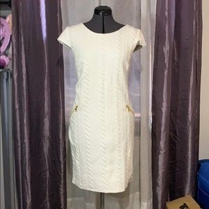 White dress with gold zipper accents